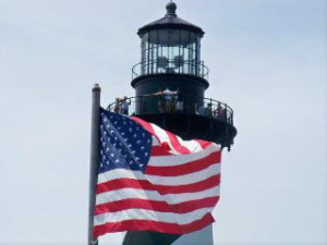 US Flag at Cape Hatteras Lighthouse by Charles B. Richardson