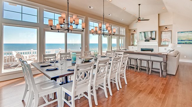 Beautiful ocean views from the dining and great room in Hatteras Grander, a Hatteras Village oceanfront vacation rental home on the Outer Banks of North Carolina