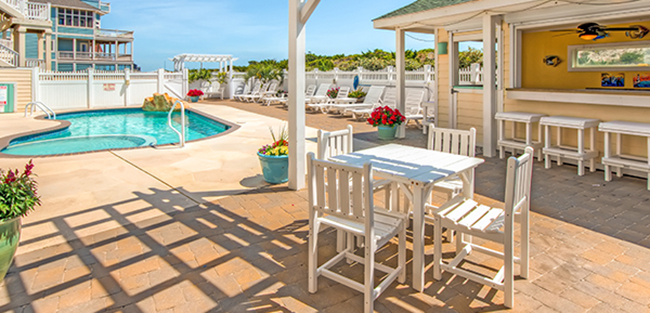 Veranda and patio by the private pool and tiki bar at Bramasole, at Bramasole, an oceanfront vacation home in Avon in Hatteras Island on the Outer Banks of North Carolina